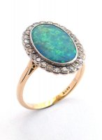 1910 - Cluster Ring, Set with Black Opal and Diamonds in 18ct. Yellow and White Gold