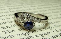 Antique Guest and Philips - Platinum Sapphire and Diamond Set, Two stone Crossover Ring