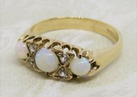 Antique Guest and Philips - Yellow Gold and Opal - Seven Stone Ring