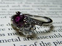 Antique Guest and Philips - Platinum Round Facetted Ruby and Round Brilliant Diamond Set 2 Stone Crossover Ring