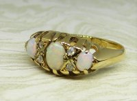Antique Guest and Philips - Yellow Gold and Opal Set - Seven Stone Ring