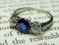 Antique Guest and Philips - Platinum Round Brilliant Diamond and Sapphire Set, Three Stone Ring