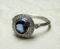 Antique Guest and Philips - Platinum Round Facetted Aquamarine and Round Brilliant Diamond Set Milligrain Halo Cluster
