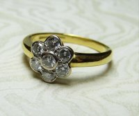 Antique Guest and Philips - White and Yellow Gold Round Brilliant Diamond Set Seven Stone Daisy Cluster Ring