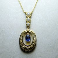 Antique Guest and Philips - Yellow Gold Oval faceted Blue Sapphire and Pearl Rubbed over Set Filigee drop pendant