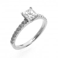 Solitaire Ring, Set with a Princess Cut Diamond in Platinum. Diamond Set Shoulders