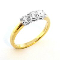 Three Stone Diamond Set Ring, in 18ct. Yellow and White Gold